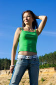 The nice girl in a green vest and jeans — Stock Photo