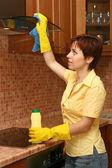 Girl on kitchen wipes technics — Stock Photo