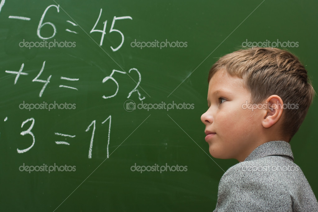 The schoolboy at a lesson of mathematics at a school board — Stock Photo #2632689
