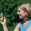 Woman with a mobile phone — Stock Photo