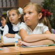 Schoolgirls in a classroom — Foto Stock