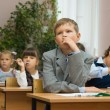 Children in a classroom at a lesson. — Stock Photo