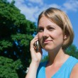 Stock Photo: The woman talks by a mobile phone