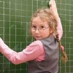 The girl wipes a blackboard — Stock Photo