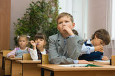 Children in a classroom at a lesson. — Стоковое фото