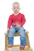 Baby sitting on a chair — Stock Photo