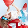 Woman with red heart baloon — Stock Photo