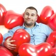 Man with red hearts — Stock Photo