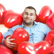 Stock Photo: Man with red hearts