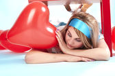 Beautiful woman with red heart — Stock Photo