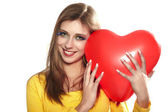 Portrait of a young woman with red heart — Stock Photo