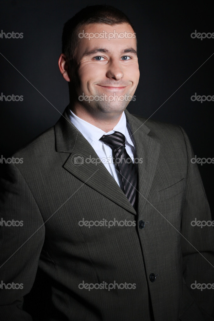 Portrait of a young happy man in a suit, studio shot — Stock Photo #1804266