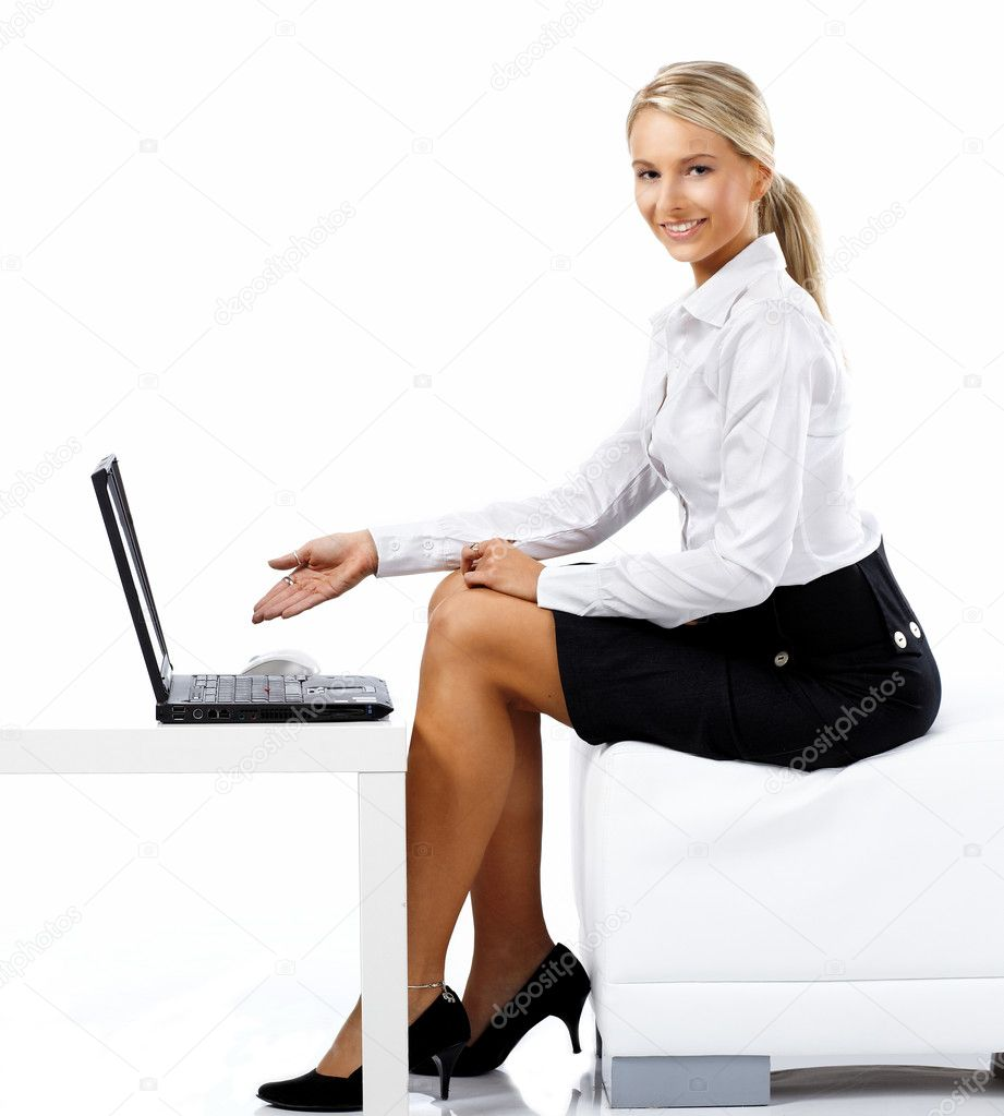  Business woman displaying a laptop computer - isolated over a white background  Stock Photo #1769951