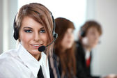 Representative smiling call center woman — Stock Photo