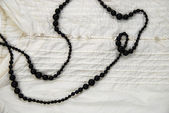 Black Necklace on white blouse — Stock Photo