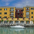 Yellow house on the lake Garda - Stock Photo