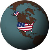 Usa flag on map of earth globe — Stock Photo