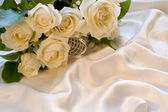 White wedding rose on silk background — Stock Photo
