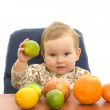 Babby and fruits — Stock Photo