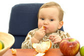 Babby eat fruit — Stock Photo