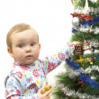 Baby and christmas tree — Stockfoto