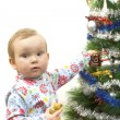 Baby and christmas tree — Stock Photo