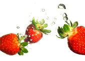 Strawberry splashing — Stock Photo