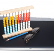 Laptop and abacus — Stock Photo