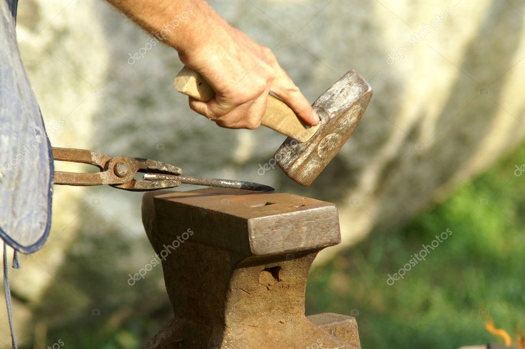 Black smith make with forge hammer an arrow — Stock Photo #2196486