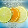 Stock Photo: Citrus slice in water