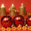 Gold candles and red glass balls — Stock Photo