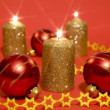 Gold candles and red glass balls - Stock Photo