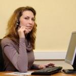 Woman using head phone — Stock Photo