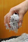 Hand holding shredded paper — Stock Photo