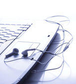 Headphones is on the touchpad — Stock Photo