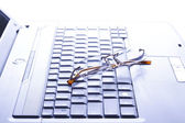 Spectacles on the keyboard — Stock Photo