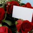 Red roses with note — Stock Photo