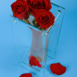 Three red roses in vase — Stock Photo #2051658
