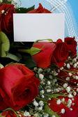 Velvet roses with note — Stock Photo