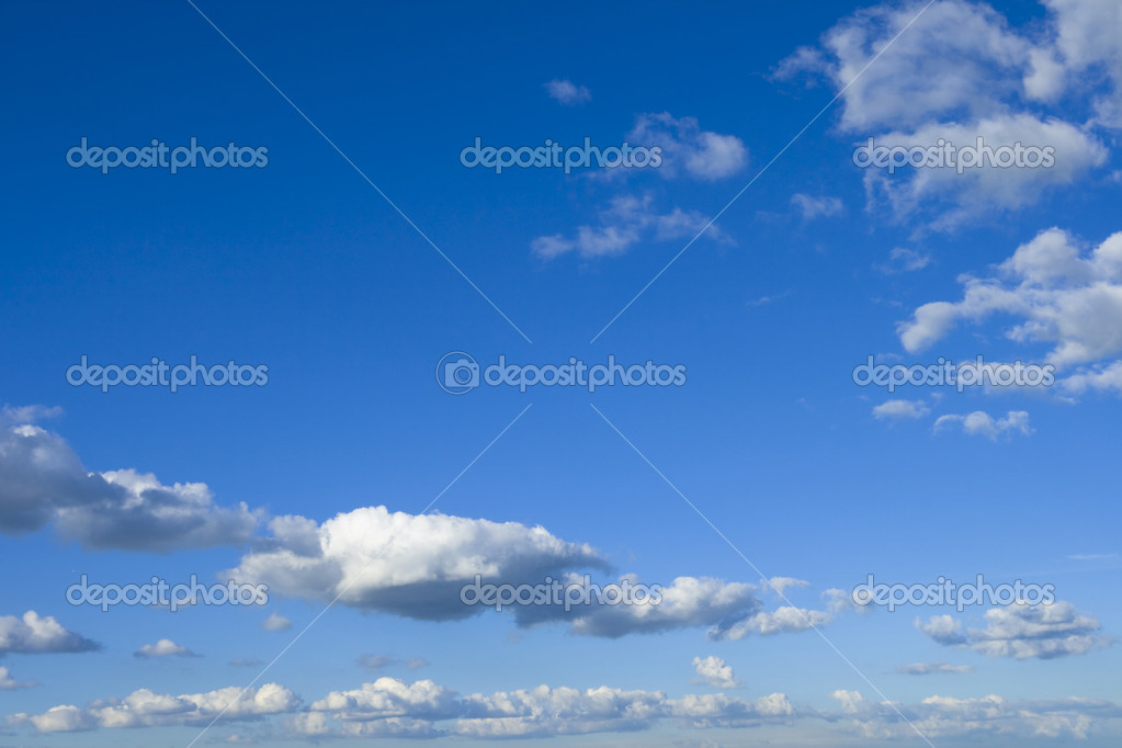 Fluffy white clouds and blue sky — Stock Photo #2052986
