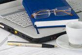 White laptop, diary, glasses — Stock Photo