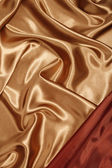 Red gold silk with red corner — Stock Photo
