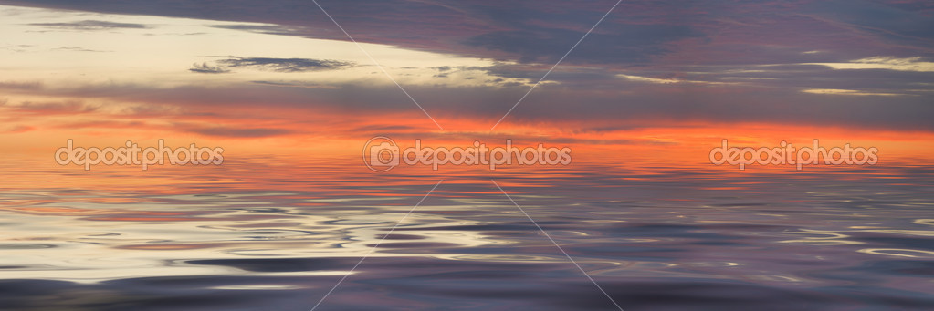 Sunset panorama and glitter water with grey clouds — Stock Photo #2323253