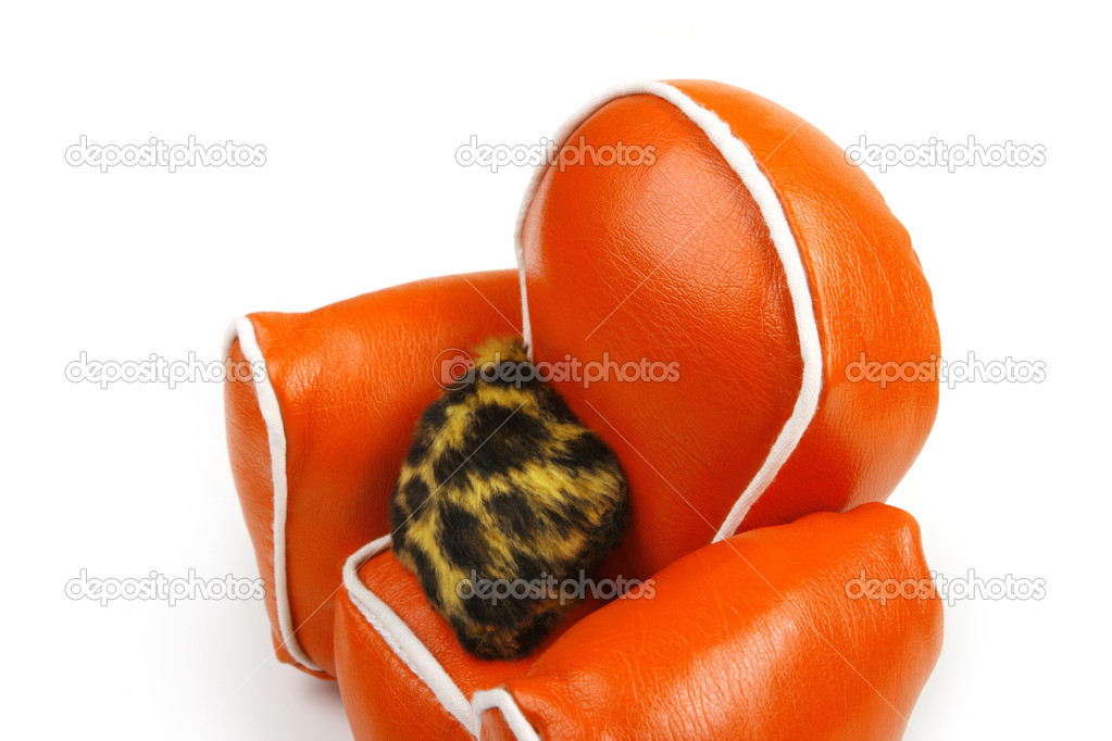 Orange chair on white, fur cushion  Stock Photo #2325002