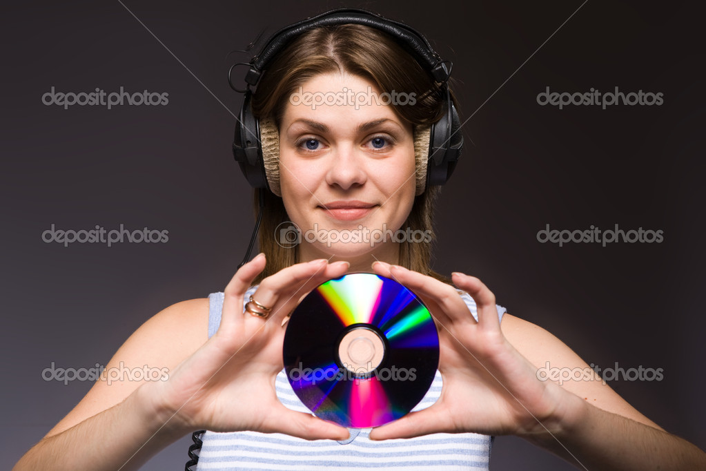 Girl with digital disc — Stock Photo #1725317