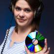 Woman holds disc — Stock Photo #2474744
