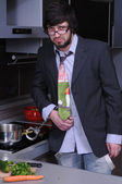 Young man in the kitchen cuffed for pan — Stock Photo