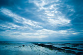 Rocky Seacoast with heavy clouds — Stock Photo