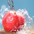 Frozen splash drop on apple — Stock Photo