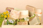 Handmade soap in wooden box — Stock Photo